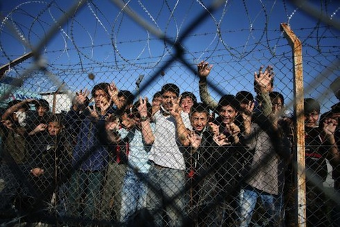 migrants and barbed wire