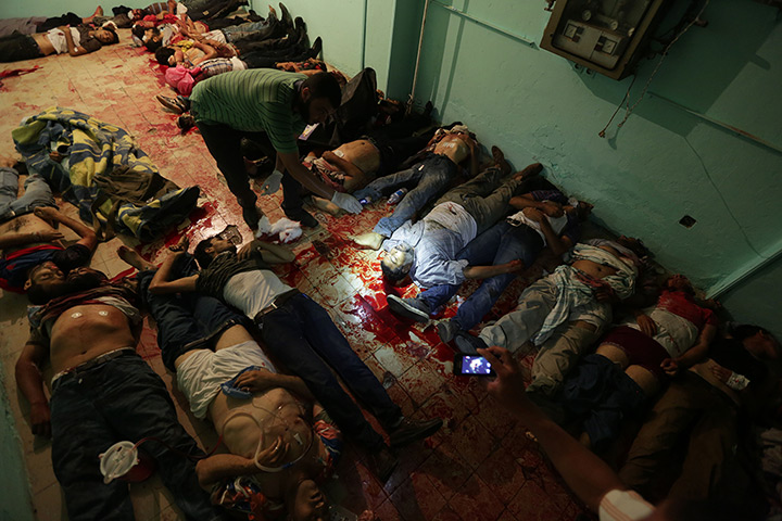 Bodies lie in a room of a hospital after a shooting happened at the Republi
