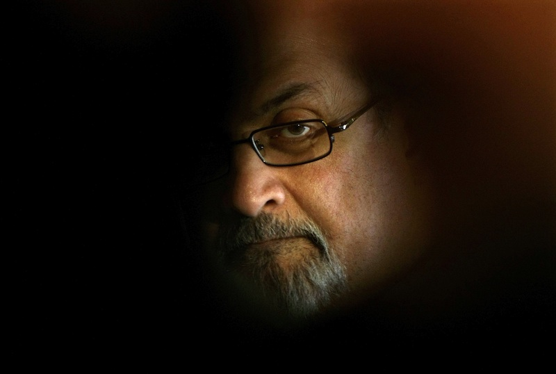 British author Salman Rushdie poses for photographers during a photocall before his news conference at Asia house in Barcelona