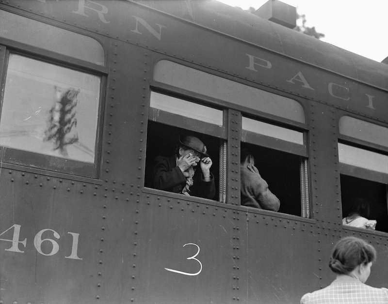 Woodland, Yolo County, California. Ten cars of evacuees of Japanese ancestry are now aboard and the . . .